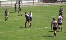 A French rugby player punches out a referee during a contest in South Africa.