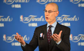 Adam Silver speaks at the podium.
