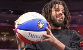 J. Cole attends the 2018 Verizon Slam Dunk Contest.
