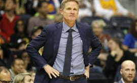 Steve Kerr reacts to a call during a Warriors game.