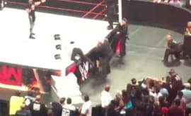 WWE fan attempts to climb into the ring to attack Seth Rollins during 'Raw.'