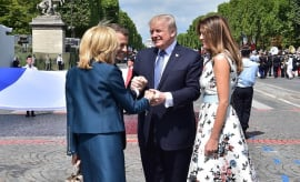 Donald Trump (2nd R) shakes hands with Emmanuel Macron and his wife Brigitte Macron