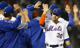 Mets players high-five one another after win.