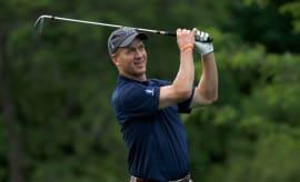 Peyton Manning golfing.