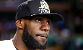 LeBron James wears championship hat after Eastern Conference Finals victory.
