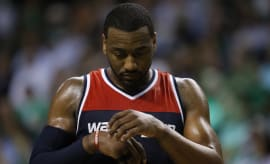 John Wall thinks about his 2K rating during game.