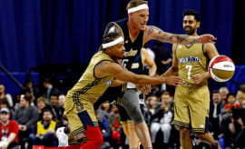 Romeo Miller battles with Jason Williams for a loose ball over All-Star weekend.
