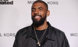 Kyrie Irving on the red carpet at a Sports Illustrated event.