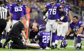 Trainers look at Adrian Peterson #28 of the Minnesota Vikings