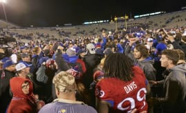 Kansas Jayhawks fans storm the field after beating Texas