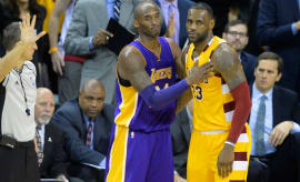 Kobe Bryant and LeBron James share a moment during the 2016 season.