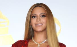 Beyonce poses in the press room at the 59th GRAMMY Award