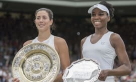 Venus Williams and Garbine Muguruza hold their Wimbledon hardware.