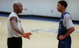 Michael Jordan instructs Rip Hamilton during a practice.