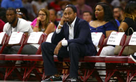 Stephen A. Smith sits courtside at a Big3 game.
