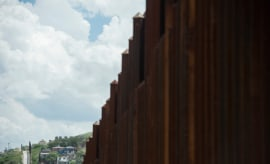 The border security fence stretches over the hills of Nogales, Ariz