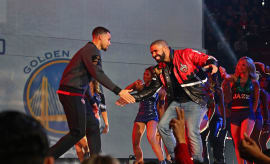 Drake introduces Stephen Curry #30 of the Western Conference