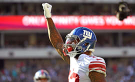 Odell Beckham celebrates by raising his fist in the air.