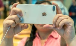 Chinese customers are trying the new iPhone 8 in an Apple store