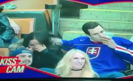 Hockey fan kisses beer at hockey game