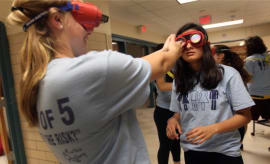 Lexington High School students try to negotiate their way wearing 'drunk goggles'