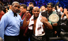 Floyd Mayweather celebrates with referee Robert Byrd after defeating Conor McGregor.