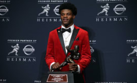 Lamar Jackson poses with the Heisman Trophy.