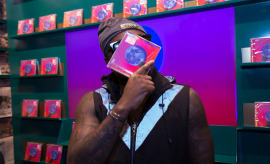 Wale poses with his new album 'Shine'