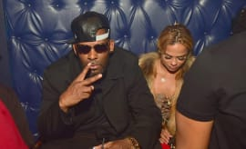 R. Kelly and Halle Calhoun attend a Party at Amora Lounge