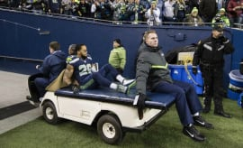 Earl Thomas is carted off the field after suffering a broken leg.