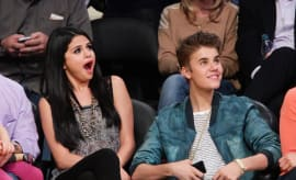 Selena Gomez and Justin Bieber attend a basketball game