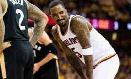 J.R. Smith laughs during a playoff game.