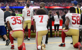 Colin Kaepernick kneels before a 2016 game.