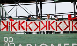 Red Sox fans post K signs to celebrate Chris Sale strikeouts.