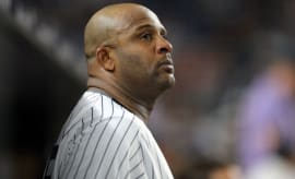 Yankess pitcher CC Sabathia stands in the dugout during a 2017 game.