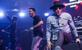 Brad Delson, Mike Shinoda and Chester Bennington of Linkin Park perform