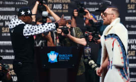 Mayweather and McGregor square off at a press conference.