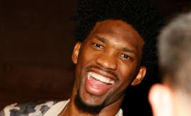 Joel Embiid laughs at an All-Star party.