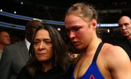 Ronda Rousey and her mother AnnMaria de Mars leave Octagon at UFC 207.