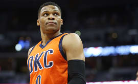 Russell Westbrook looks into crowd during game.