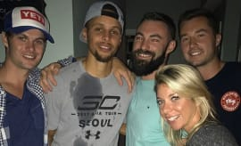 Stephen Curry poses with some people after crashing a house party.
