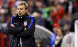 Jurgen Klinsmann crosses his arms for warmth, and getting left out in the cold by the USMNT.