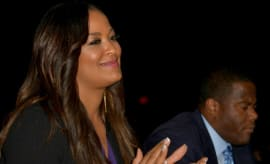 Laila Ali claps at a WBC event.