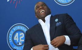 Magic Johnson laughs at a ceremony where the Dodgers unveiled a Jackie Robinson statue