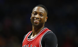 Dwyane Wade smiles at the haters.