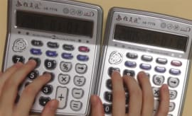 Despacito being played on two calculators