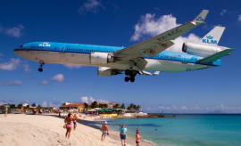A KLM MD-11 lands over Maho Beach
