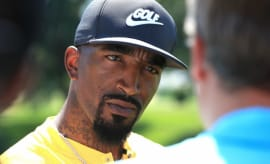 J.R. Smith speaks with a reporter.