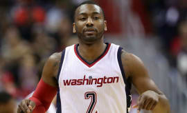 John Wall celebrates the Wizards win over the Celtics.
