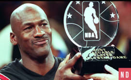 Michael Jordan holds up an All-Star Game MVP Trophy